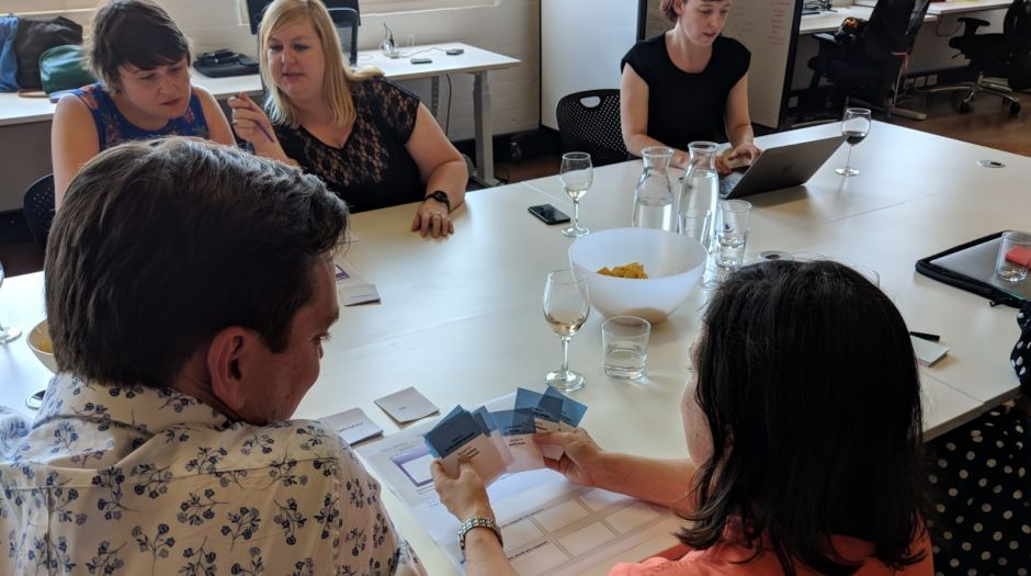 People try the ThinkPlace game Cards Against Neutrality