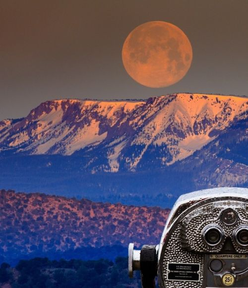 Telescope looking at mountains in the distance